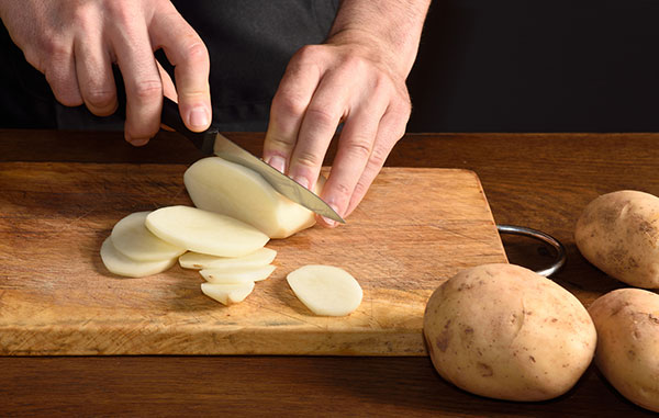 thinly slice potatoes